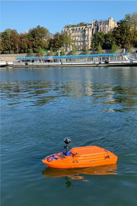 Small orange boat on water
